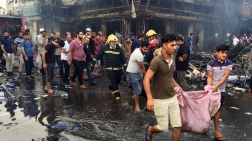 Iraqi firefighters and civilians evacuate bodies of victims killed from a car bomb at a commercial area in Karada neighborhood, Baghdad, Iraq, Sunday, July 3, 2016. Bombs went off early Sunday in two crowded commercial areas in Baghdad. (AP Photo/Khalid Mohammed)